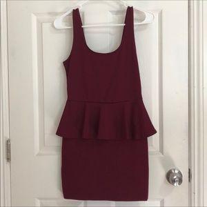 Peplum mini dress in a gorgeous burgundy color